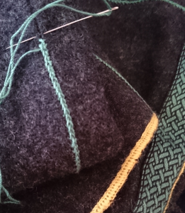Decorating the seams and hems of an apron dress.