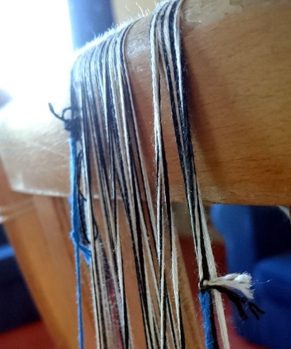 threads over a wooden bar