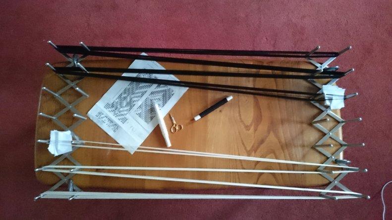 warp threads wound onto a board