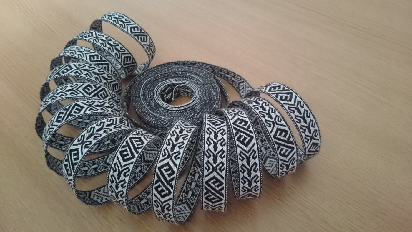 several metres of trim coiled into a shell shape.