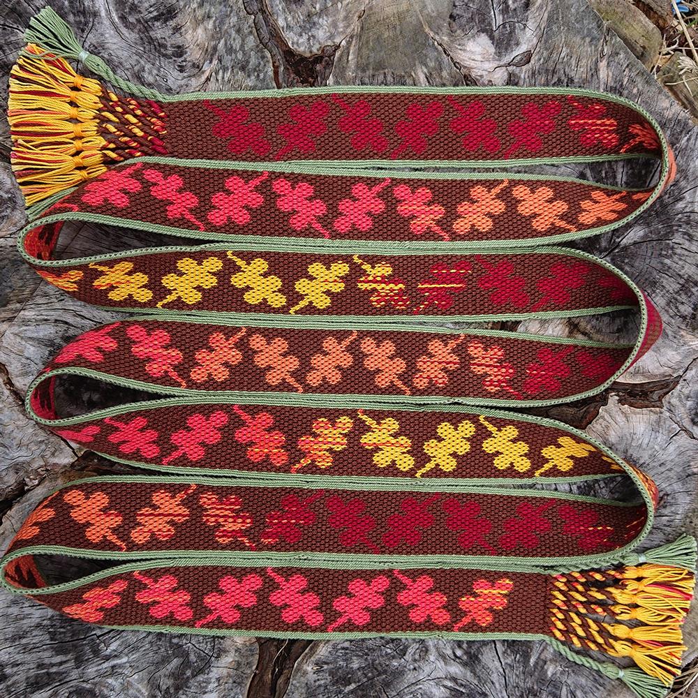 A fabric belt with an oak leaf pattern along it